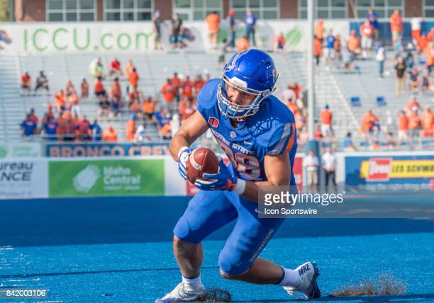 Boise State Broncos tight end Jake Roh tries to maintain his balance after a catch during the nonconference season opener between the Troy Trojans...