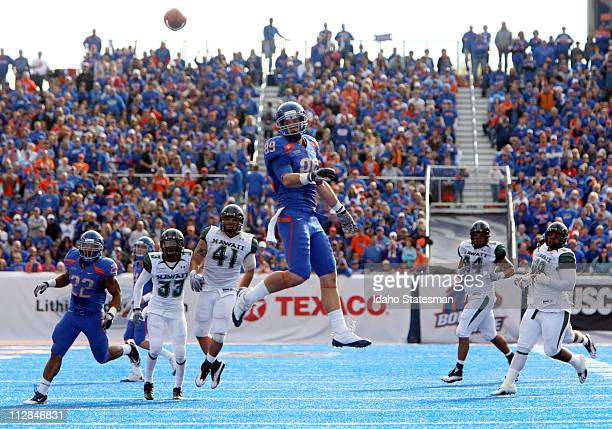 Boise State Broncos wide receiver Tyler Shoemaker is overthrown by Boise State Broncos quarterback Kellen Moore against Hawaii at Bronco Stadium in...