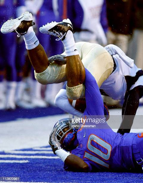 Boise State defensive back Jerrell Gavins upends UC Davis wide receiver Chris Carter at Bronco Stadium in Boise Idaho Saturday October 3 2009