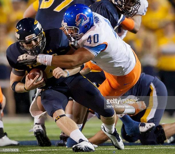 Boise State defensive end Tyrone Crawford sacks Toledo quarterback Austin Dantin left at Glass Bowl Stadium in Toledo Ohio on Friday September 16 2011