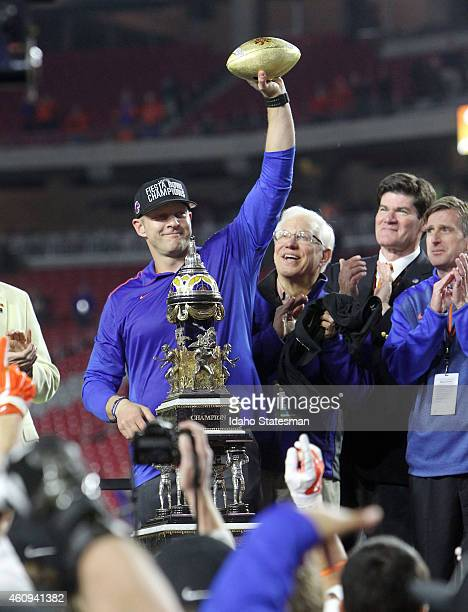 Boise State head coach Bryan Harsin hoists the trophy after a 3830 win against Arizona in the Vizio Fiesta Bowl at the University of Phoenix Stadium...