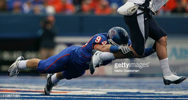 Boise State linebacker Bryon Hout pressures Utah State quarterback Sean Setzer at Bronco Stadium in Boise Idaho on Saturday November 8 2008 Boise...