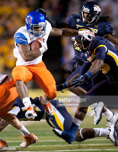 Boise State running back Doug Martin hurdles a Toledo defender to break through the line of scrimmage at Glass Bowl Stadium in Toledo Ohio on Friday...