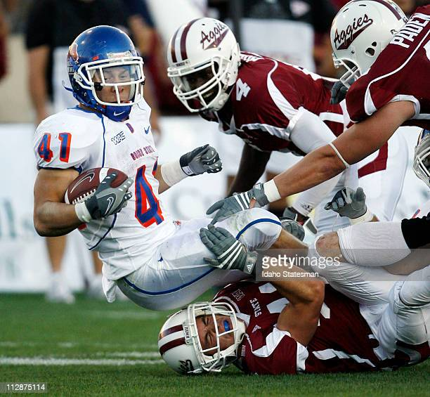 Boise State running back Ian Johnson emerges from a pack of New Mexico Aggies for a Bronco gain in the first quarter on Saturday November 1 in Las...