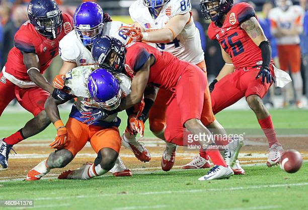 Boise State running back Jay Ajayi fumbles the ball away in the second half against Arizona in the Vizio Fiesta Bowl at the University of Phoenix...