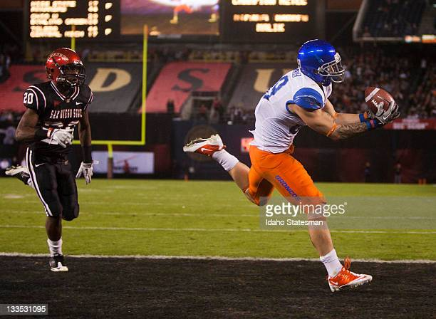 Boise State wide receiver Tyler Shoemaker right catches the football in stride inside the end zone for a Bronco touchdown against San Diego State on...