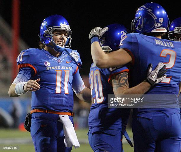 Boise State's Kellen Moore celebrates with teammates after his second touchdown pass a 2yarder to Matt Miller at the MAACO Las Vegas Bowl on Thursday...