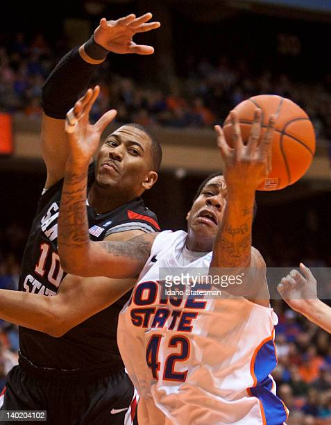 Boise State's Kenny Buckner fights for an offensive rebound with San Diego State's Tim Shelton left at Taco Bell Arena in Boise Idaho on Wednesday...