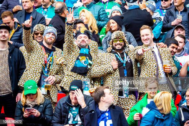 Boisterous Jaguars fans all wearing suits made in the colors of the Jaguars before the NFL game between the Philadelphia Eagles and the Jacksonville...