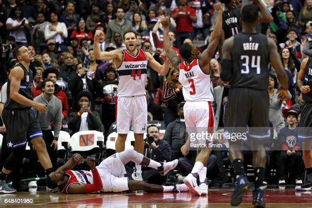 Bojan Bogdanovic Bradley Beal and John Wall of the Washington Wizards celebrate after defeating Aaron Gordon and the Orlando Magic at Verizon Center...
