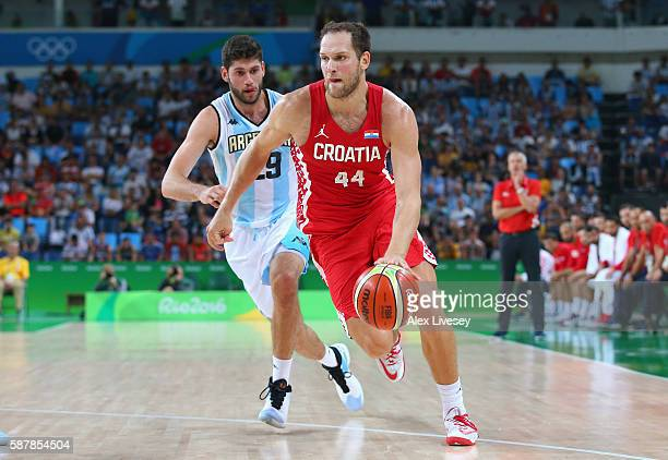 Bojan Bogdanovic of Croatia moves the ball against Patricio Garino of Argentina during a preliminary round basketball game between Croatia and...