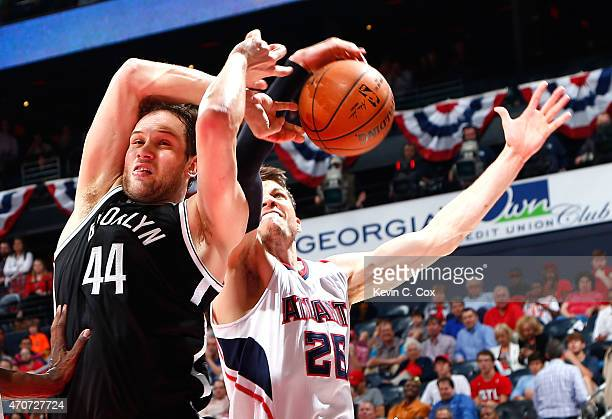 Bojan Bogdanovic of the Brooklyn Nets draws a foul as Kyle Korver of the Atlanta Hawks attempts to strip the ball during Game Two of the Eastern...