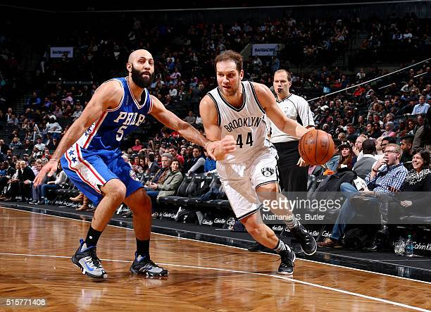 Bojan Bogdanovic of the Brooklyn Nets handles the ball against Kendall Marshall of the Philadelphia 76ers on March 15 2016 at Barclays Center in...