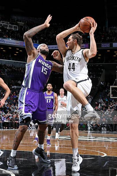 Bojan Bogdanovic of the Brooklyn Nets looks to pass the ball while guarded by DeMarcus Cousins of the Sacramento Kings on November 27 2016 at...
