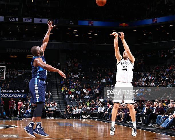 Bojan Bogdanovic of the Brooklyn Nets shoots against the Raymond Felton of the Dallas Mavericks during the game on December 23 2015 at Barclays...