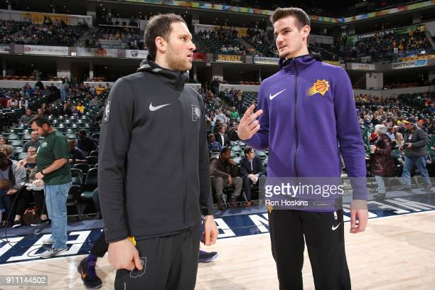 Bojan Bogdanovic of the Indiana Pacers and Dragan Bender of the Phoenix Suns talk before the game on January 24 2018 at Bankers Life Fieldhouse in...