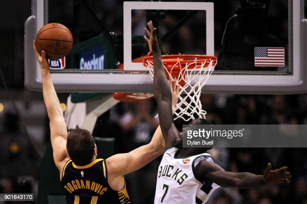 Bojan Bogdanovic of the Indiana Pacers attempts a shot while being guarded by Thon Maker of the Milwaukee Bucks in the first quarter at the Bradley...