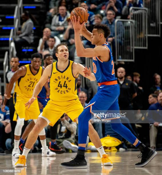 Bojan Bogdanovic of the Indiana Pacers attempts to get the ball from Kevin Knox of the New York Knicks during a game at Bankers Life Fieldhouse on...