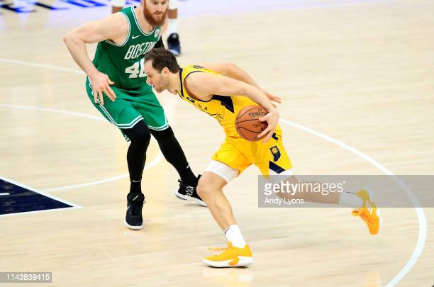 Bojan Bogdanovic of the Indiana Pacers dribbles the ball against the Boston Celtics in game three of the first round of the 2019 NBA Playoffs at...