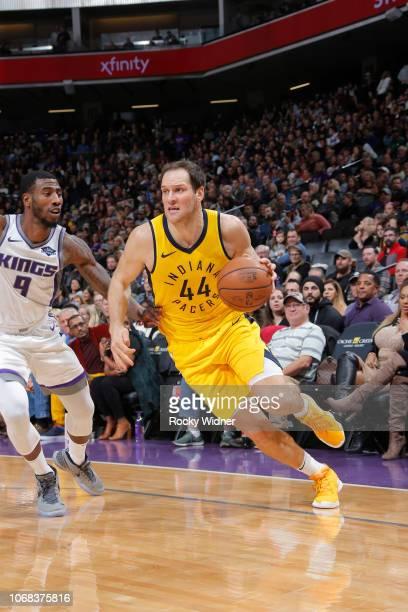 Bojan Bogdanovic of the Indiana Pacers drives against Iman Shumpert of the Sacramento Kings on December 1 2018 at Golden 1 Center in Sacramento...