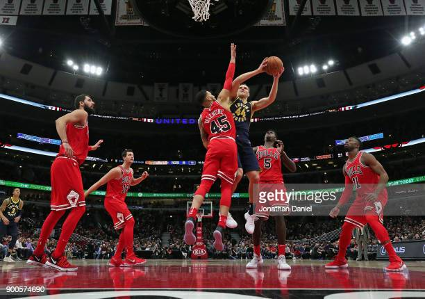 Bojan Bogdanovic of the Indiana Pacers drives against Nikola Mirotic Paul Zipser Denzel Valentine Bobby Portis and David Nwaba of the Chicago Bulls...