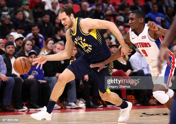 Bojan Bogdanovic of the Indiana Pacers drives around Langston Galloway of the Detroit Pistons during the first half at Little Caesars Arena on...