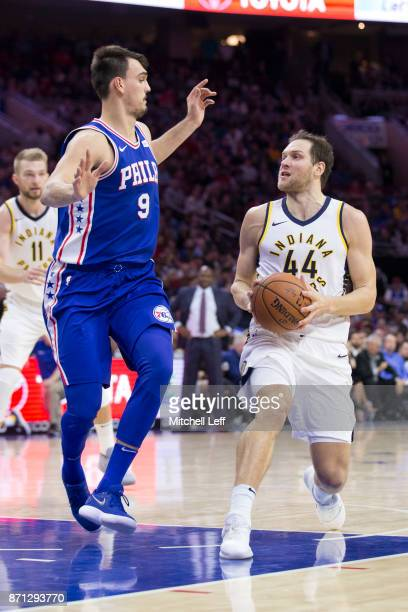 Bojan Bogdanovic of the Indiana Pacers drives to the basket against Dario Saric of the Philadelphia 76ers at the Wells Fargo Center on November 3...