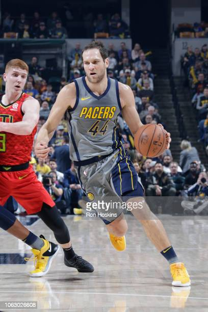 Bojan Bogdanovic of the Indiana Pacers handles the ball against the Atlanta Hawks on November 17 2018 at Bankers Life Fieldhouse in Indianapolis...