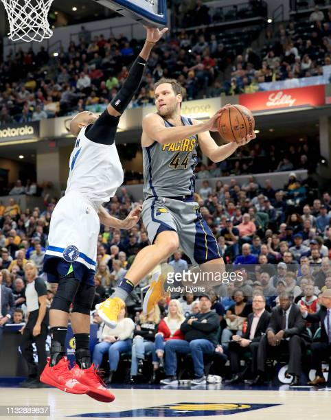 Bojan Bogdanovic of the Indiana Pacers looks to pass the ball against the Minnesota Timberwolves at Bankers Life Fieldhouse on February 28 2019 in...