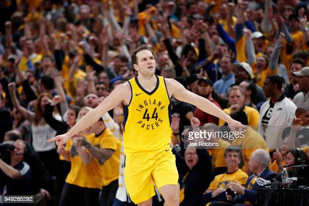 Bojan Bogdanovic of the Indiana Pacers reacts after making a threepoint shot in the second half of game three of the NBA Playoffs against the...