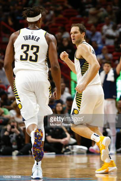 Bojan Bogdanovic of the Indiana Pacers reacts after making a three pointer against the Miami Heat during the second half at American Airlines Arena...