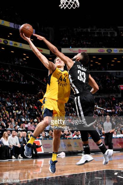 Bojan Bogdanovic of the Indiana Pacers shoots the ball against Allen Crabbe of the Brooklyn Nets during the game between the two teams on February 14...