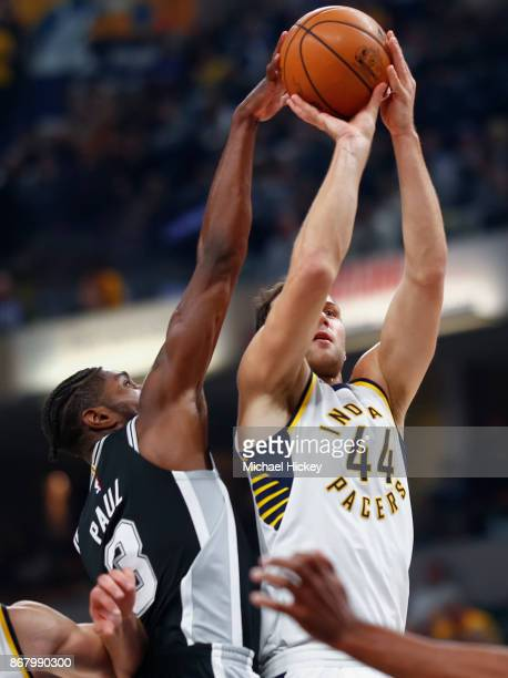 Bojan Bogdanovic of the Indiana Pacers shoots the ball as Brandon Paul of the San Antonio Spurs defends at Bankers Life Fieldhouse on October 29 2017...