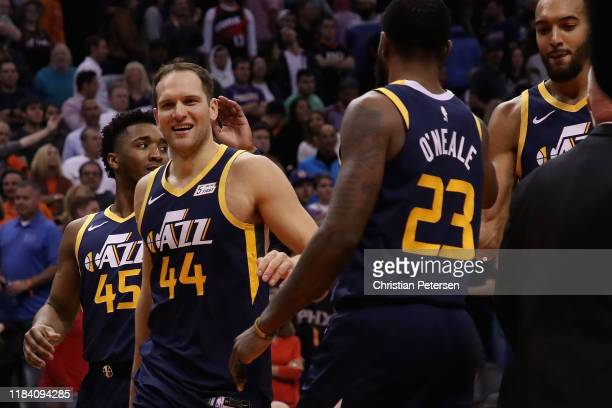 Bojan Bogdanovic of the Utah Jazz celebrates with Donovan Mitchell and Royce O'Neale following the NBA game against the Phoenix Suns at Talking Stick...