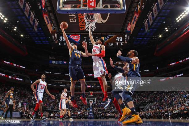 Bojan Bogdanovic of the Utah Jazz drives to the basket while Christian Wood of the Detroit Pistons plays defense during the game on March 7 2020 at...