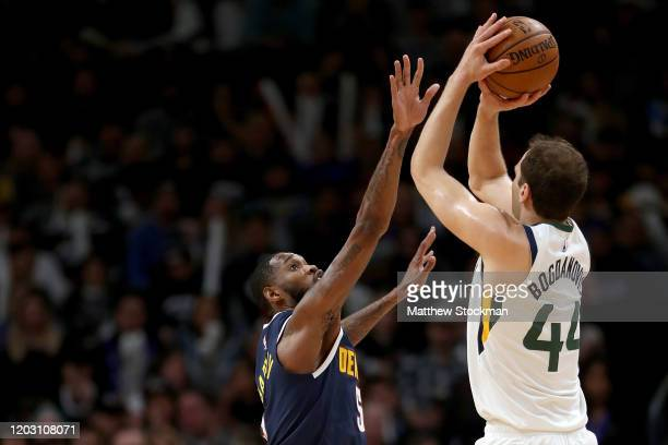 Bojan Bogdanovic of the Utah Jazz puts up a shot against Will Barton III of the Denver Nuggets in the first quarter at the Pepsi Center on January 30...