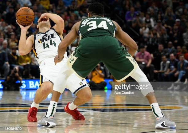 Bojan Bogdanovic of the Utah Jazz reacts after getting hit in the eye by Giannis Antetokounmpo of the Milwaukee Bucks during a game at Vivint Smart...