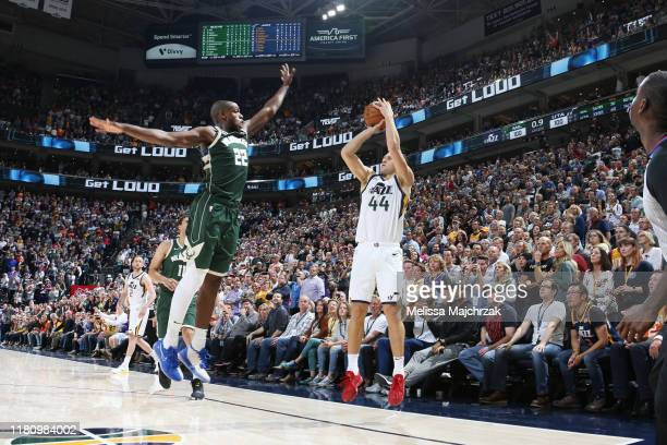Bojan Bogdanovic of the Utah Jazz shoots a three-pointer to win the game against the Milwaukee Bucks on November 8, 2019 at Vivint Smart Home Arena...