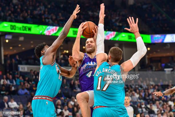 Bojan Bogdanovic of the Utah Jazz shoots between Jaren Jackson Jr #13 and Jonas Valanciunas of the Memphis Grizzlies during the first half at...