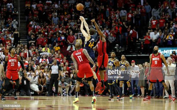 Bojan Bogdanovic of the Utah Jazz shoots the game winning shot defended by James Harden of the Houston Rockets and PJ Tucker in the fourth quarter at...