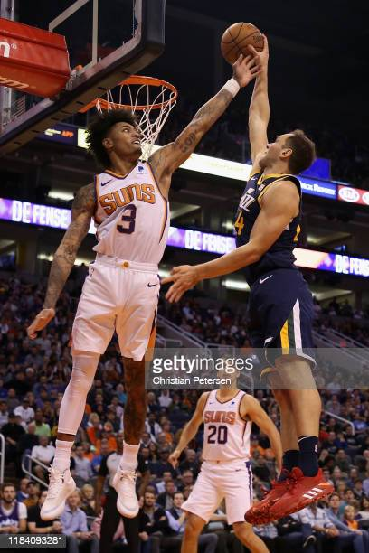 Bojan Bogdanovic of the Utah Jazz slam dunks the ball against Kelly Oubre Jr #3 of the Phoenix Suns during the second half of the NBA game at Talking...