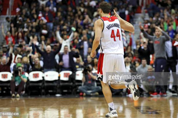 Bojan Bogdanovic of the Washington Wizards reacts after making a basket against the Orlando Magic during the second half at Verizon Center on March 5...
