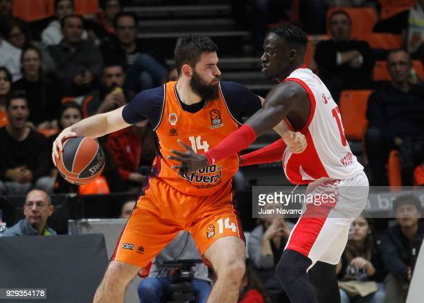 Bojan Dubljevic #14 of Valencia Basket competes with Ilimane Diop #12 of Baskonia Vitoria Gasteiz during the 2017/2018 Turkish Airlines EuroLeague...