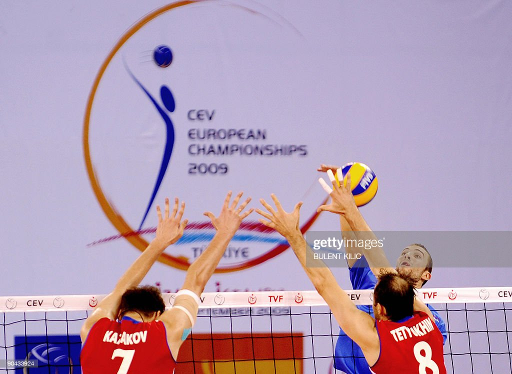 Bojan Janic of Serbia spikes the ball over the net as ...
