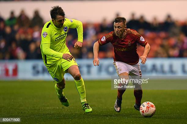 Bojan Jokic of Nottingham Forest chases down Dale Stephens of Brighton and Hove Albion during the Sky bet Championship match between Nottingham...