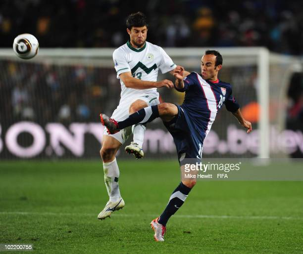 Bojan Jokic of Slovenia is challenged by Landon Donovan of the United States during the 2010 FIFA World Cup South Africa Group C match between...