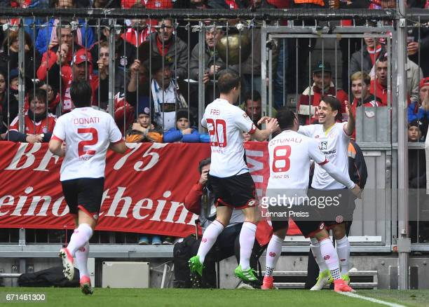 Bojan Krkic of 1 FSV Mainz 05 and his teammates celebrate the opening goal during the Bundesliga match between Bayern Muenchen and 1 FSV Mainz 05 at...