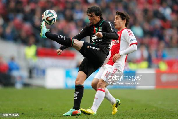 Bojan Krkic of Ajax and Jeffrey Leiwakabessy of NEC battle for the ball during the Eredivisie match between Ajax Amsterdam and NEC Nijmegen at...