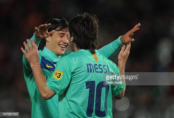 Bojan Krkic of Barcelona celebrates with Lionel Messi after scoring a goal during the La Liga match between UD Almeria and Barcelona at Estadio del...