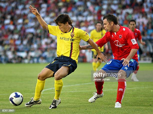 Bojan Krkic of Barcelona duels for the ball with Alvaro Anton of Numancia during the La Liga match between Numancia and Barcelona at the Los...